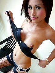 Ladyboy Fon with big enhanced tits and a willing hard cock in stockings