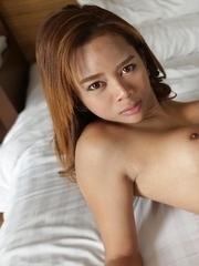 Sexy Thai ladyboy Mond takes a good ass pounding from big white cock