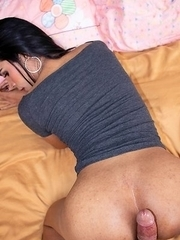 Ladyboy Wan is at the desk wearing a tight, deep grey blouse and jean shorty shorts.